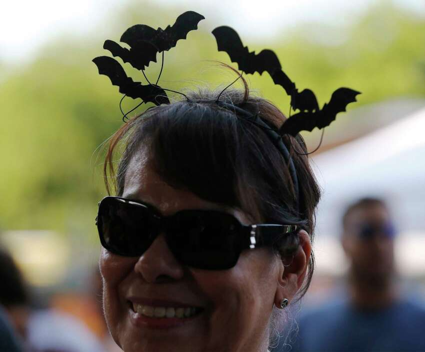 Ruby Carroll wears a hair band of bats while attending the 5th Annual Bat Loco Bash on Tuesday, Aug. 8, 2017. The San Antonio River Authority (SARA), Texas Parks and Wildlife Department (TPWD), and Bat Conservation International (BCI) hosted the event near Camden St. bridge on the Museum Reach segment of the San Antonio River Walk. The free, family-friendly event included a bat parade, educational booths, food trucks, live music and bat friends. The Bash is part of San Antonio's Kidcation Week which runs from August 5 through August 13. The public is invited to bring their chairs as SARA staff will lead the talk about the bat colony that currently resides under I-35 while sharing information related to the San Antonio River and the Museum Reach. Wildlife experts from TPWD and BCI will provide bat education and explain the important role bats have in the South Texas ecosystem.