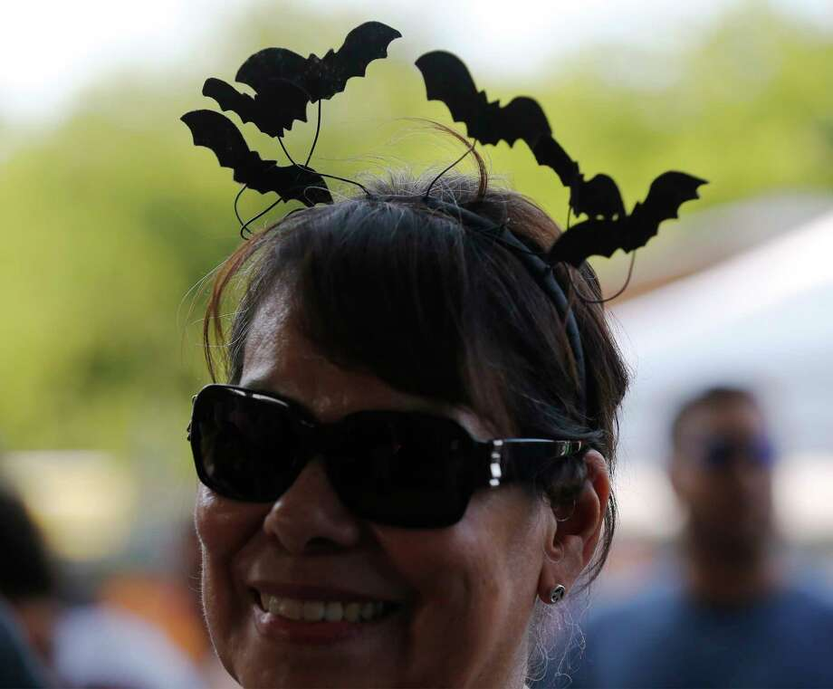 Ruby Carroll wears a hair band of bats while attending the 5th Annual Bat Loco Bash on Tuesday, Aug. 8, 2017. The San Antonio River Authority (SARA), Texas Parks and Wildlife Department (TPWD), and Bat Conservation International (BCI) hosted the event near Camden St. bridge on the Museum Reach segment of the San Antonio River Walk. The free, family-friendly event included a bat parade, educational booths, food trucks, live music and bat friends. The Bash is part of San Antonio's Kidcation Week which runs from August 5 through August 13. The public is invited to bring their chairs as SARA staff will lead the talk about the bat colony that currently resides under I-35 while sharing information related to the San Antonio River and the Museum Reach. Wildlife experts from TPWD and BCI will provide bat education and explain the important role bats have in the South Texas ecosystem. Photo: Kin Man Hui, San Antonio Express-News / ©2017 San Antonio Express-News