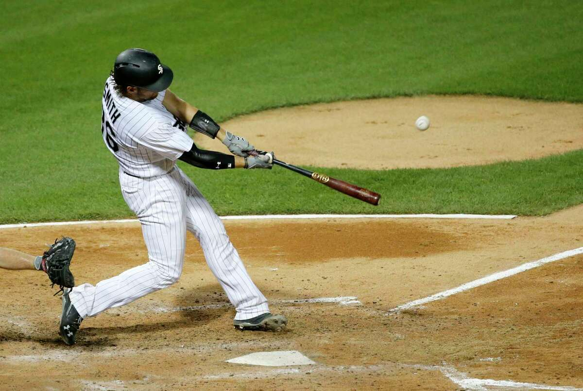 Chicago White Sox's Kevan Smith hits a two-run home run off Houston Astros starting pitcher Dallas Keuchel during the fourth inning of a baseball game, Tuesday, Aug. 8, 2017, in Chicago. Jose Abreu also scored on the play. (AP Photo/Charles Rex Arbogast)