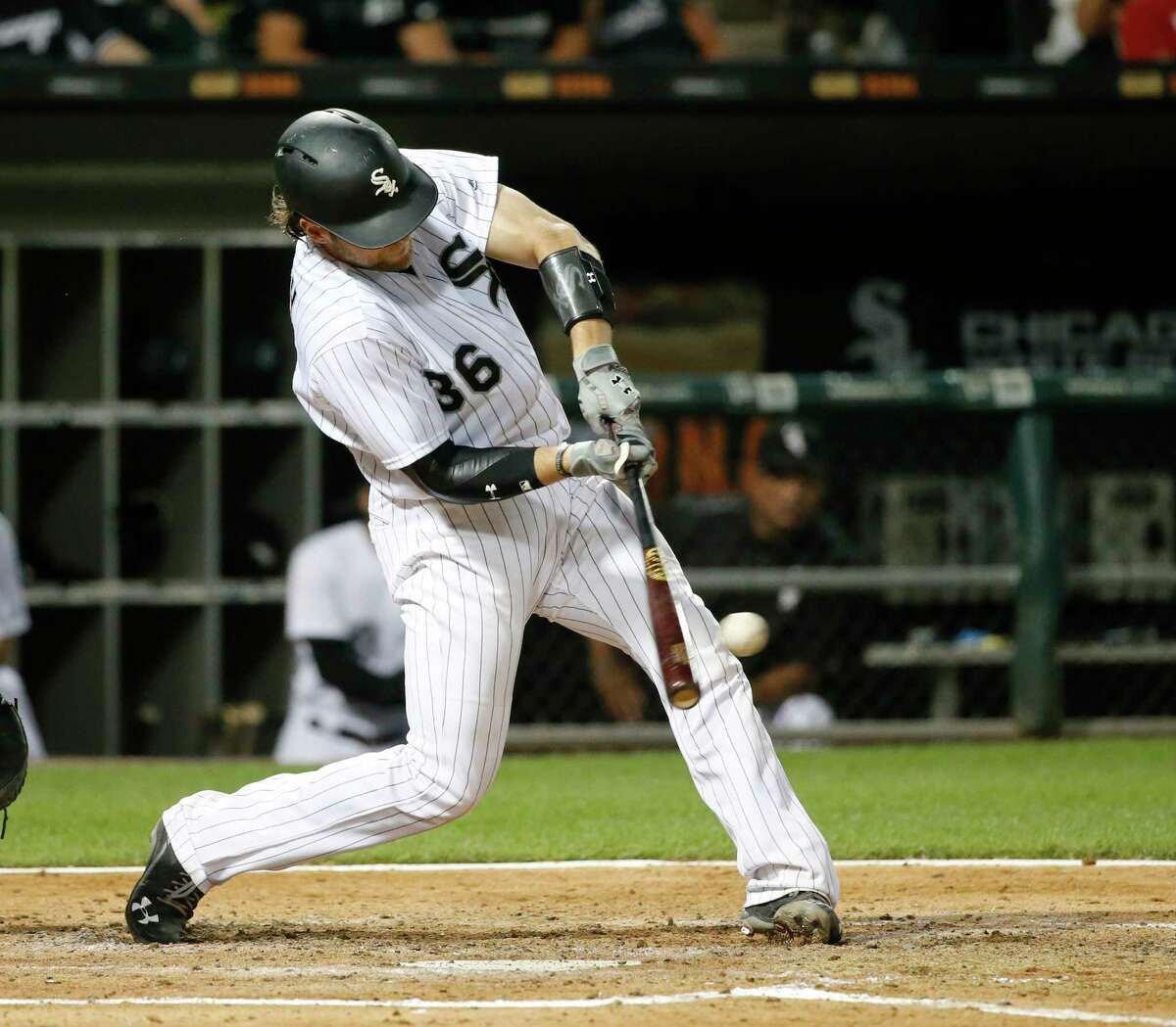Chicago White Sox's Kevan Smith hits a two-run double off Houston Astros starting pitcher Dallas Keuchel during the third inning of a baseball game Tuesday, Aug. 8, 2017, in Chicago. Jose Abreu and Avisail Garcia scored on the play. (AP Photo/Charles Rex Arbogast)