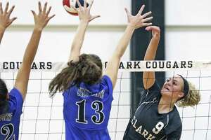Mary Beth Buchman slams a cross shot over Ellie Wipf (13) and Allison Smylie as Clark hosts New Braunfels in volleyball at Clark gym on August 8, 2017.