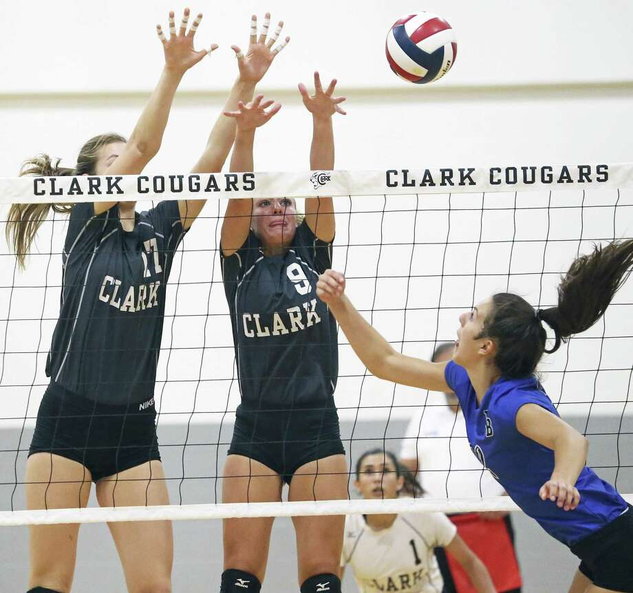 Clark players Kara McGhee (17) and Mary Beth Buchman knock a shot by Allison Smylie down as Clark hosts New Braunfels in volleyball at Clark gym on August 8, 2017. Photo: Tom Reel, Staff / San Antonio Express-News / 2017 SAN ANTONIO EXPRESS-NEWS