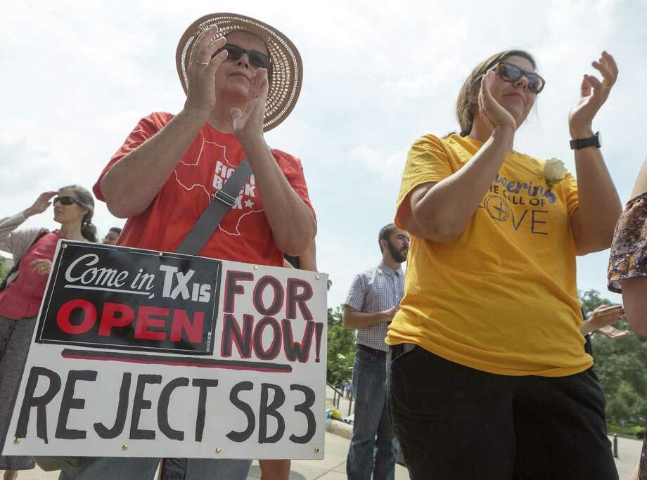 """Mercy Lawler, left, and Kristina Borden attend the """"Keep Texas Open for Business"""" event at the Texas Capitol in Austin, Tuesday, Aug. 8, 2017. Those in attendance urged the Texas Legislator to reject the bathroom bill. (Stephen Spillman / for Express-News) Photo: Stephen Spillman / Stephen Spillman / stephenspillman@me.com Stephen Spillman"""