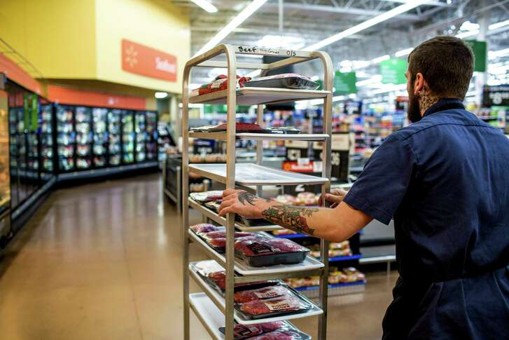 Mac Guile runs the meat department at the Walmart in Fulton, N.Y. Guile, who started at Walmart at 19 as a janitor, says the Walmart Academy taught him how to better motivate his workers.