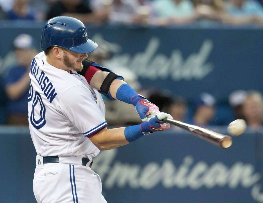 Toronto Blue Jays' Josh Donaldson hits a two run home run against the New York Yankees during the third inning of their baseball game in Toronto on Tuesday, Aug. 8, 2017. (Fred Thornhill/The Canadian Press via AP) ORG XMIT: FJT108 Photo: Fred Thornhill / The Canadian Press