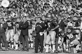 Notre Dame head coach Ara Parseghian and quarterback Terry Hanratty (5) watch Georgia Tech kick a field goal during the first quarter on Nov. 18, 1967. Parseghian, who took over a foundering Notre Dame football program and restored it to glory with two national championships in 11 seasons, died Wednesday, Aug. 2, 2017, at his home in Granger, Ind. He was 94.