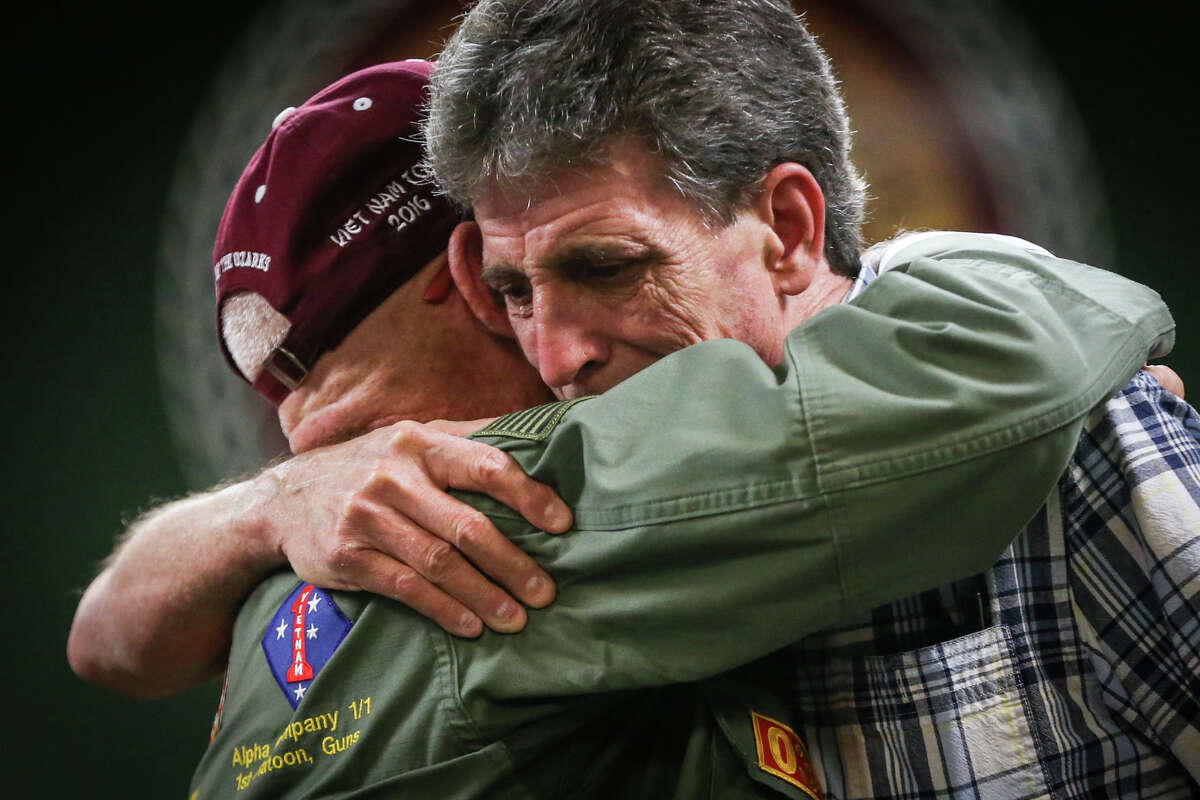 Vietnam Veteran Eddie Neas, left, embraces Magnolia resident Brian Dale Freed, right, as he becomes overwhelmed with emotion during a ceremony on Tuesday, Aug. 8, 2017, at Magnolia City Hall.