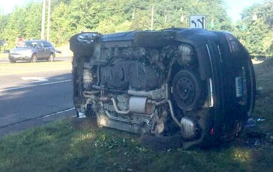 A car lays on its side on Grist Mill Road after it crashed Aug. 9 near Route 7 in Norwalk following a high-sped pursuit from Westport. Photo: Contributed Photo / Connecticut Post Contributed