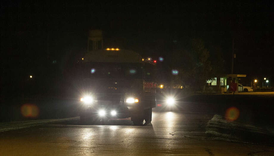 The first bus that is moving heat-sensitive inmates to other facilities leaves the Wallace Pack Unit at around 5 a.m. Wednesday, Aug. 9, 2017, in Navasota. The inmates will be sent to 11 other facilities. ( Yi-Chin Lee / Houston Chronicle ) Photo: Yi-Chin Lee   Houston Chronicle