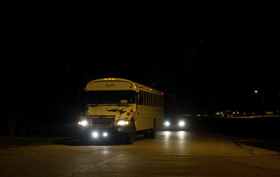 The first bus that is moving heat-sensitive inmates to other facilities leaves the Wallace Pack Unit at around 5 a.m. Wednesday, Aug. 9, 2017, in Navasota. The inmates will be sent to 11 other facilities. ( Yi-Chin Lee / Houston Chronicle ) Photo: Yi-Chin Lee | Houston Chronicle