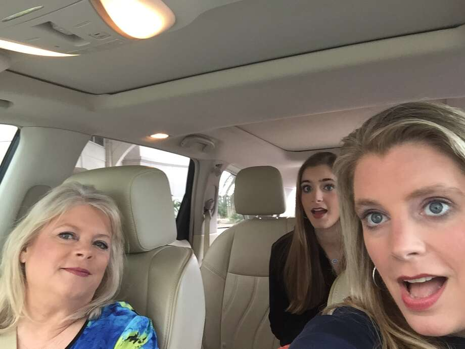 """Marcy Johnson is a passenger as her daughter, Jodi Rutledge, drives and her granddaughter, Macy Rutledge sits in the back seat. GoPro cameras filmed them in their car as they drove from one property to another during filming of an episode of HGTV's """"Beachfront Bargain Hunt."""" The show will air at 7:30 p.m. Aug. 27. Photo: Courtesy Of Marcy Johnson"""