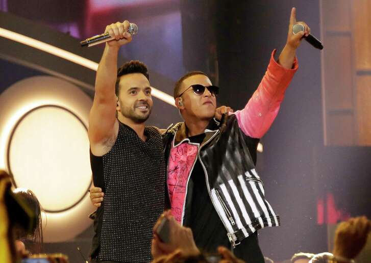 """FILE - This April 27, 2017 file photo shows singers Luis Fonsi, left, and Daddy Yankee during the Latin Billboard Awards in Coral Gables, Fla. The success of their hit song """"Despacito,"""" has stretched beyond its Latin audience, becoming the year's most recognized song in the United States and other countries, and has opened doors for more Spanish tracks to be played on American radio without English lyrics. (AP Photo/Lynne Sladky, File)"""