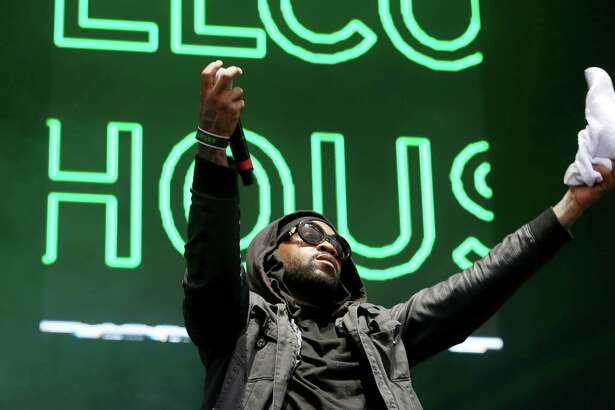 """Rapper Mike Jones asks the audience to raise their volume while performing the """"Welcome to Houston all-star rap set"""" segment at Day for Night festival Saturday, Dec. 17, 2016, in Houston. ( Yi-Chin Lee / Houston Chronicle )"""