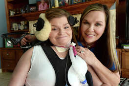 Melissa and daughter Lauren McMillan will cross the stage together at the Lamar University's December commencement. Melissa decided to enroll and earn her college degree after spending time assisting Lauren in her college classes. Lauren has been paralyzed since a car accident in 2002, when their car was struck on the way to school by a driver who fell asleep at the wheel.  Photo taken Tuesday, August 1, 2017 Kim Brent/The Enterprise