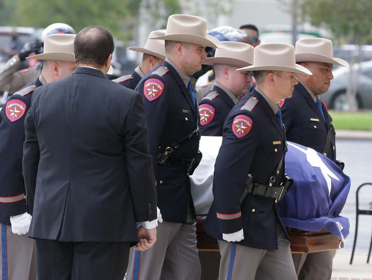 Texas Dept. Public Safety Honor Guard members escort the casket for the memorial service for former Texas Governor Mark White at Second Baptist Church, 6400 Woodway, Wednesday, August 9, 2017. ( Melissa Phillip / Houston Chronicle )