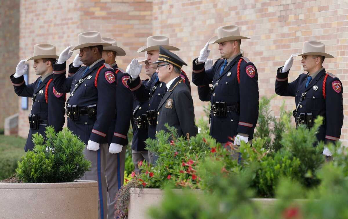 Texas Dept. Public Safety Honor Guard members salute as the hearse arrives with casket for the memorial service for former Texas Governor Mark White at Second Baptist Church, 6400 Woodway, Wednesday, August 9, 2017. ( Melissa Phillip / Houston Chronicle )