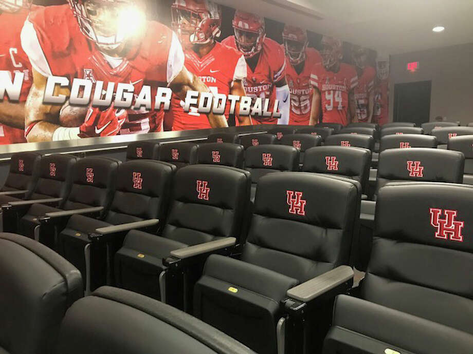 The University of Houston has a mural of former star players on a wall in the football team's auditorium. Photo: Joseph Duarte