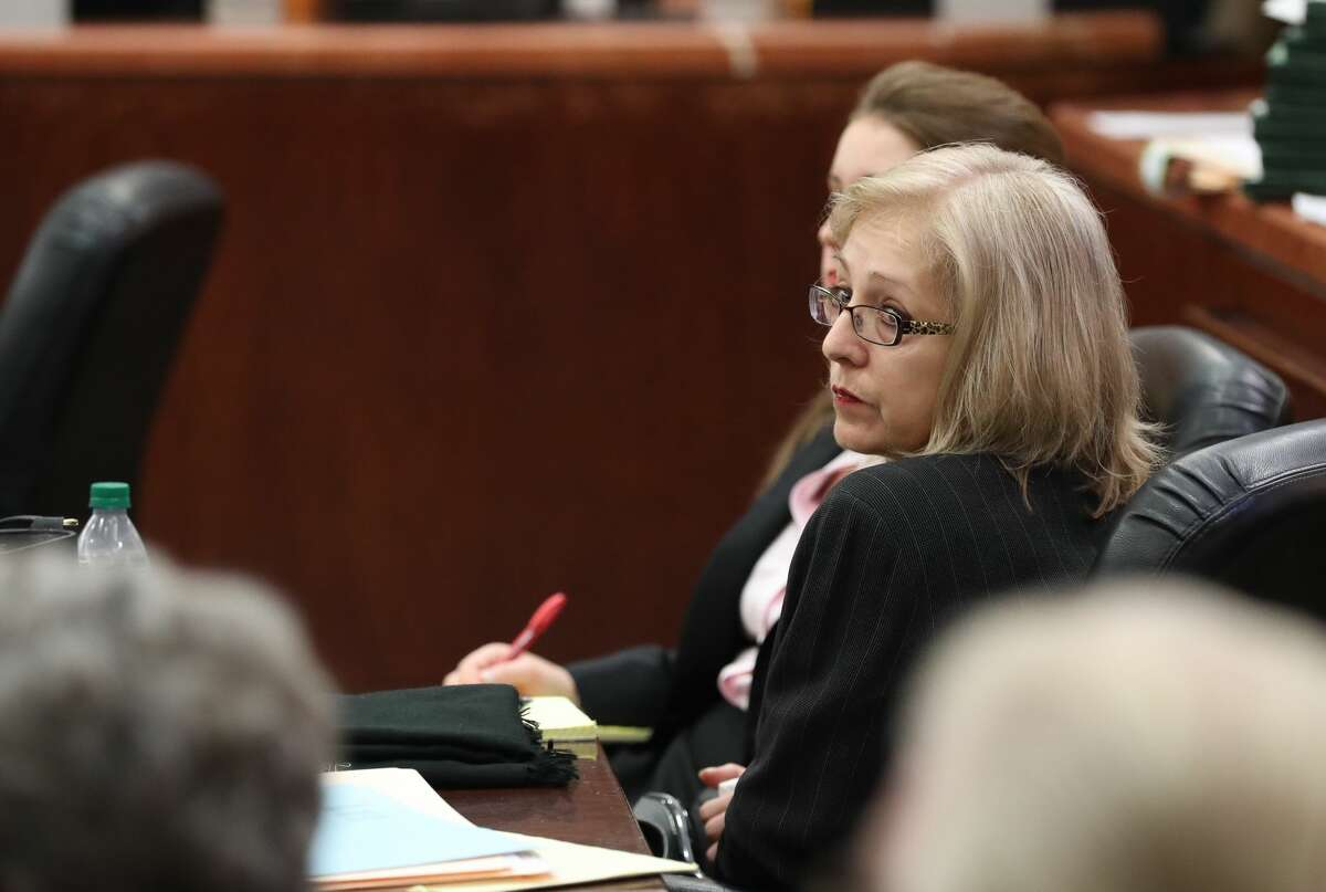 Sandra Melgar, a 57-year-old widow accused of killing her husband in 2012 and trying to cover it up in one of Houston's more bizarre cases in recent years listens to opening arguments Wednesday, August 9, 2017 in Houston.