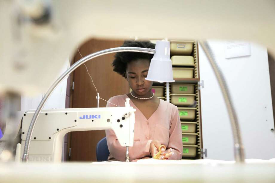Mekayla Hughes, a Cypress Ridge junior, sews a sleeping bag liners that will be sent to the International Space Station for NASAon Thursday, July 13, 2017, in Houston. Hughes plans to study fashion design and merchandising after high school. The project is part of NASA HUNCH (High School Students United with NASA to Create Hardware), a program that pairs the space program with high schools to manufacture items used by astronauts. ( Elizabeth Conley / Houston Chronicle ) Photo: Elizabeth Conley, Staff / Houston Chronicle / © 2017 Houston Chronicle