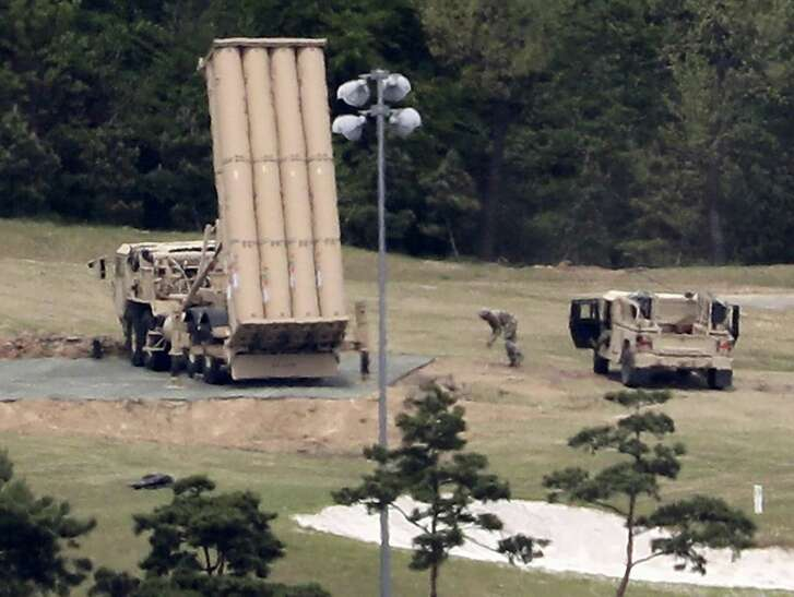 In this May file photo, a U.S. missile defense system called Terminal High Altitude Area Defense, or THAAD, is installed on a golf course in Seongju, South Korea. The threat to Japan from North Korea has reached a new stage now that the country is capable of launching an intercontinental ballistic missile and its nuclear weapons program has advanced, a defense ministry report said Tuesday, Aug. 8, 2017. The THAAD system, which was developed in Texas, was deployed last year in South Korea, much to the irritation of China, which has opposed the installation of systems it suspects could be used to conduct surveillance from outside its borders.