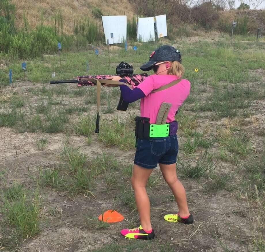 Junior competitive shooter, Addysson Soltau, or Alpha Addy, trains at the LoneStar Handgun in Converse.   Photo: Photo JeriLynn Thorpe