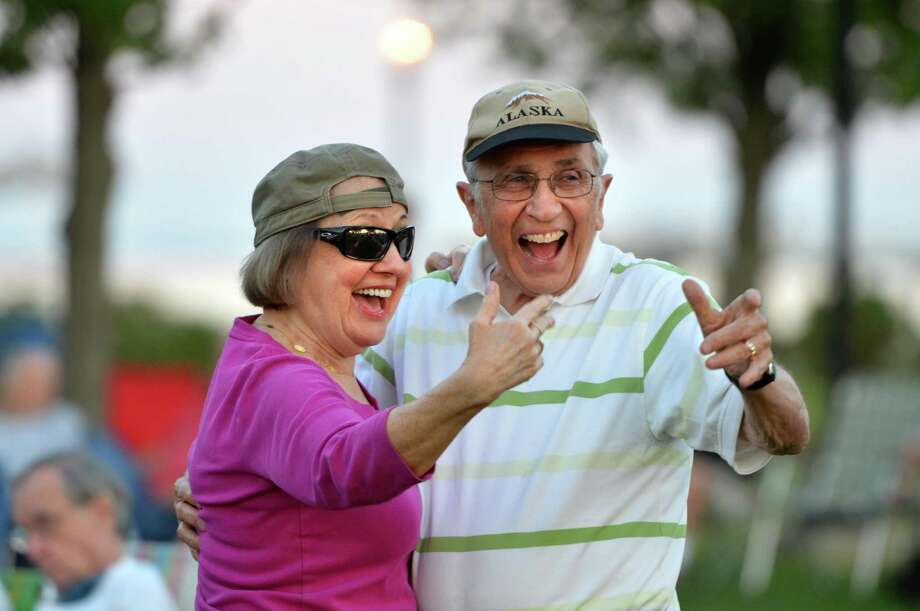 Alan and Trudy Dubrow urge others to dance as the Fairfield Counts play music from the Big Band era during the Third Taxing District Summer Concert Series at Calf Pasture Beach on Tuesday, Aug. 8, in Norwalk. Next in the free concert series is Billy and the Showmen at 7 p.m. on Sunday at Calf Pasture Beach. Photo: Alex Von Kleydorff / Hearst Connecticut Media / Norwalk Hour