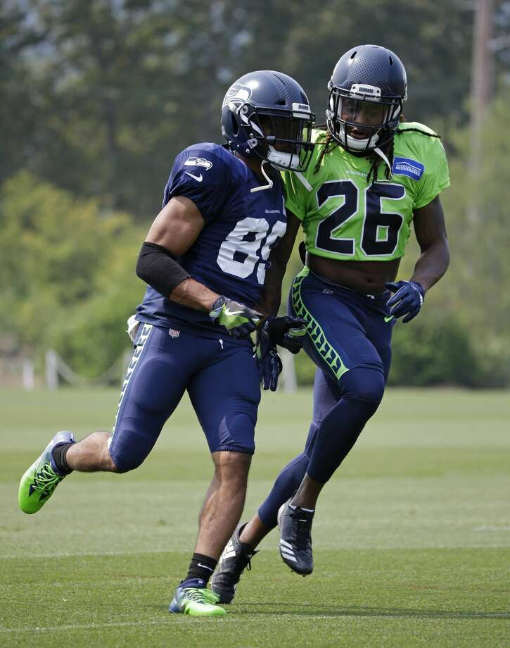 Seattle Seahawks rookie cornerback Shaquill Griffin (26) runs with wide receiver Doug Baldwin, left, during an NFL football training camp, Monday, Aug. 7, 2017, in Renton, Wash. (AP Photo/Ted S. Warren) Photo: Ted S. Warren/AP
