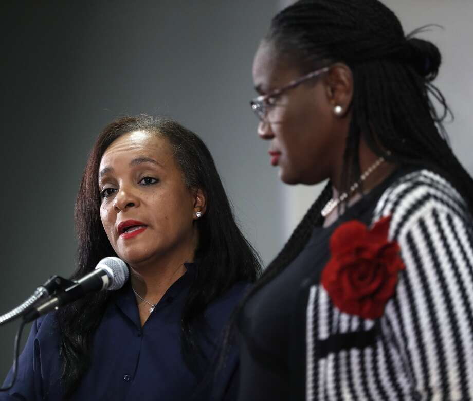 HISD trustee Rhonda Skillern-Jones speaks with board president Wanda Adams during a press conference at HISD, Wednesday, Aug. 9, 2017, in Houston, to talk about the state takeover due to chronically failing Houston schools. (Karen Warren / Houston Chronicle )