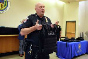 Colonie Police Chief John Jonathan Teale displays a heavy-duty protective vest which was purchased with grant money received from Albany County through the New York State Division of Criminal Justice Services on Wednesday, Aug. 9, 2017, at the Colonie Public Safety Center in Colonie, N.Y. The 20-pound vests, which can stop a common riffle round, will be added to patrol cars in addition to Kevlar helmets, that were also purchased through the $249,000 grant. The new vests would be worn over the top of existing gear during an emergency.  (Will Waldron/Times Union)Ê