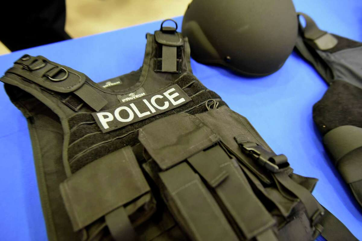 Kevlar helmets and heavy-duty protective vest purchased with grant money received from Albany County through the New York State Division of Criminal Justice Services are displayed during a press conference at the Colonie Public Safety Center on Wednesday, Aug. 9, 2017, in Colonie, N.Y. The 20 pound vests, which can stop a common riffle round, will be added to patrol cars in addition to the helmets. The new vests would be worn over the top of existing gear during an emergency. (Will Waldron/Times Union)