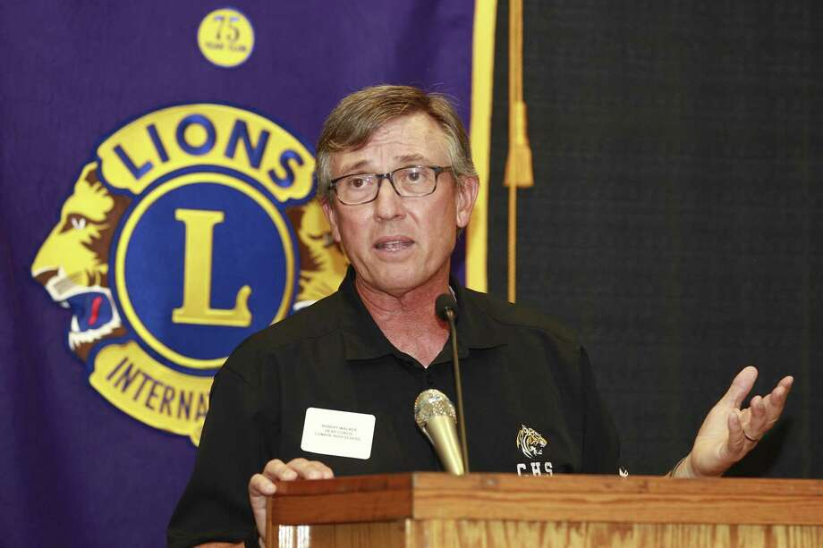 Conroe head coach Robert Walker speaks about the upcoming season during the Conroe Noon Lions Club's annual Pigskin Preview at the Lone Start Convention & Expo Center, Wednesday, Aug. 9, 2017, in Conroe. Photo: Jason Fochtman, Staff Photographer / Conroe Courier / HCN