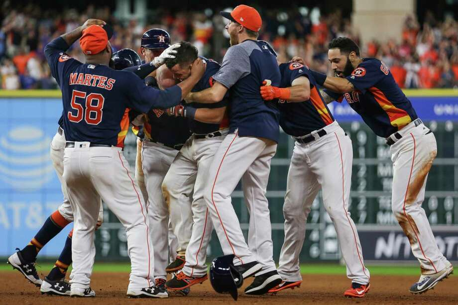 Despite a roster riddled with injuries, the resilient Astros managed to pull off a memorable four-run rally to win Sunday's homestand finale against Toronto. The real test, however, will come during the crucible of October. Photo: Michael Ciaglo, Staff / Michael Ciaglo