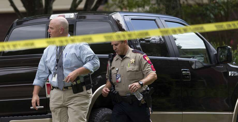 Homicide and Violent Crimes Deceive Sgt. Paul Hahs with the Montgomery County Sheriff's Office investigates the discovery of the body of a male in a wooded area near Dakota Ridge Place, Wednesday, Aug. 9, 2017, in The Woodlands. Photo: Jason Fochtman/Houston Chronicle