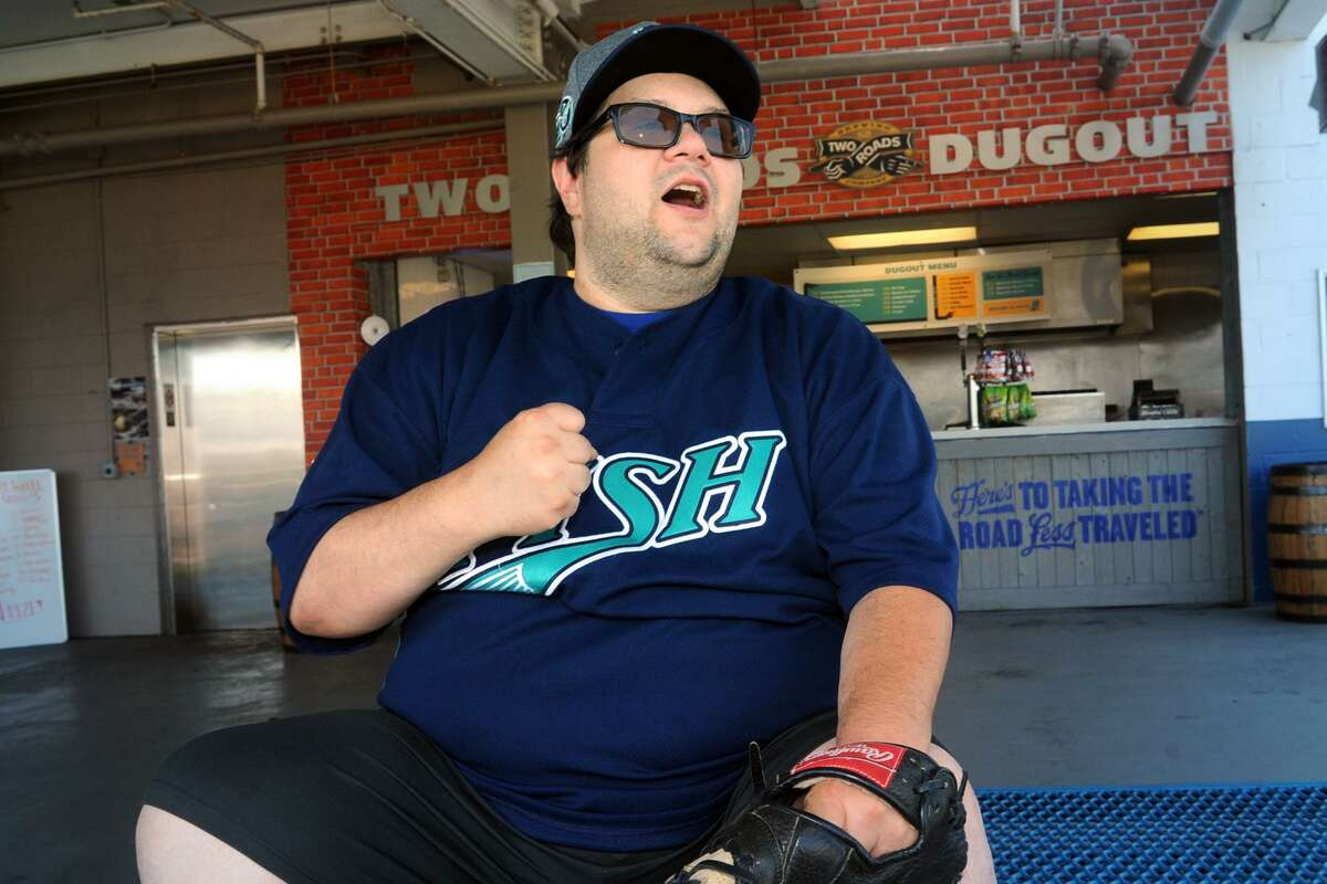 Kenny Gregory, of Branford, cheers for the Bridgeport Bluefish during the first game of their double-header against the Lancaster Barnstormers at the Ballpark at Harboryard, in Bridgeport, Conn. Aug. 9, 2017.Gregory said the two games Wednesday were the 499th and 500th Bluefish games he attended.
