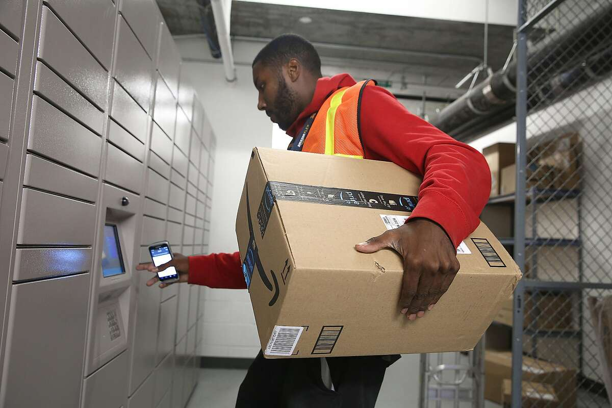 Dionte Devon Gates delivers Amazon packages to an Amazon Hub at Trinity Place on Wednesday, August 9, 2017, in San Francisco, Calif.. Amazon started Hub, a service where residents of apartment buildings receive packages in on-site lockers.
