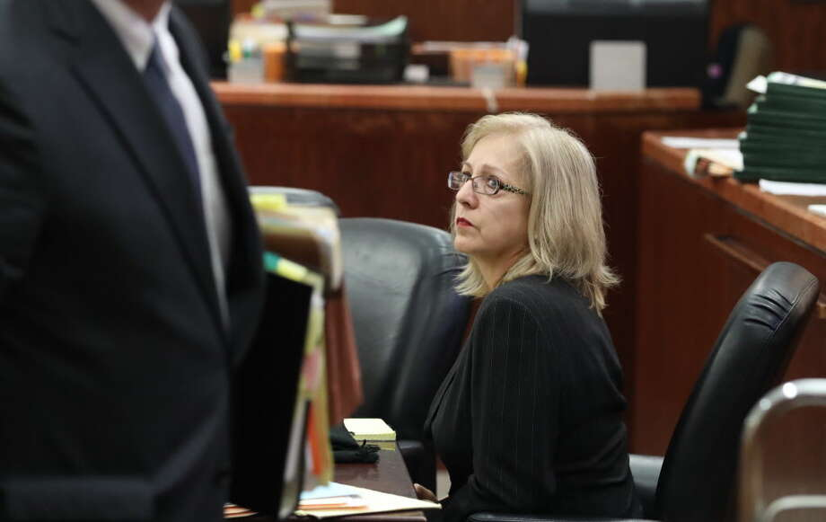 Sandra Melgar, a 57-year-old widow accused of killing her husband in 2012 and trying to cover it up in one of Houston's more bizarre cases in recent years listens to opening arguments Wednesday, August 9, 2017 in Houston.  Sandra Melgar is accused of staging a home invasion and tying herself up in a closet in her northwest Harris County home to be discovered by friends arriving for a party the next day. Prosecutors believe she was trying to cover up the fatal stabbing of her husband of 32 years. Photo: Steve Gonzales, Steve Gonzales / Houston Chronicle / 2017