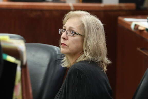 Sandra Melgar, a 57-year-old widow accused of killing her husband in 2012 and trying to cover it up in one of Houston's more bizarre cases in recent years listens to opening arguments Wednesday, August 9, 2017 in Houston.  Sandra Melgar is accused of staging a home invasion and tying herself up in a closet in her northwest Harris County home to be discovered by friends arriving for a party the next day. Prosecutors believe she was trying to cover up the fatal stabbing of her husband of 32 years.
