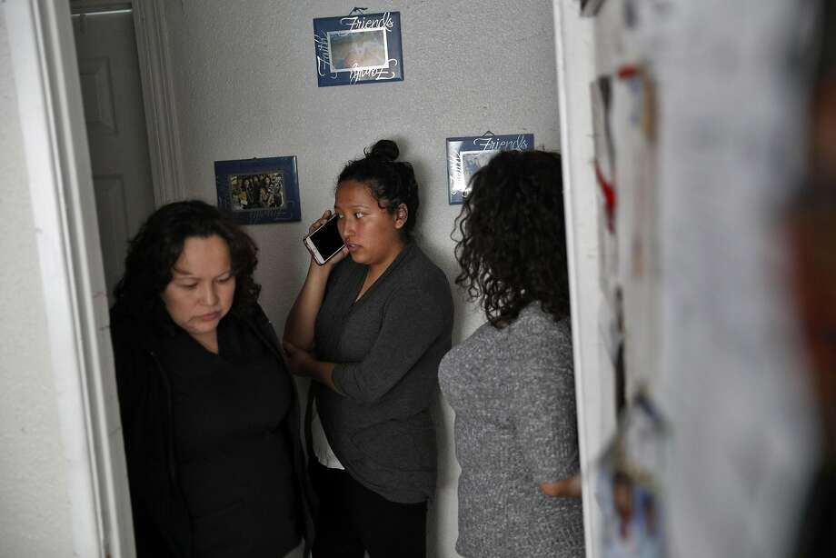 Maria Mendoza-Sanchez (left) prepares to leave for work as her daughter Melin talks on the phone. The family is devastated by a deportation order that is sending the parents from their Oakland home back to Mexico. Photo: Carlos Avila Gonzalez, The Chronicle