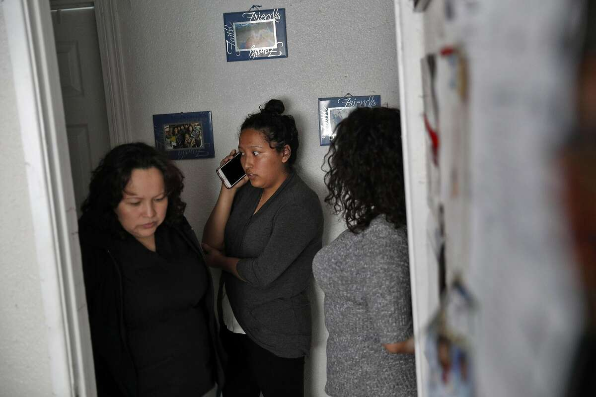 Maria Mendoza Sanchez prepares to leave for work from her home as her daughters, Melin, center, and Dianney, right, talk to a reporter about their parents' deportation dilemna in Oakland, Calif., on Tuesday, August 8, 2017. Mendoza Sanchez and her husband Eusebio are from Mexico, and the pair have four children -- three of whom are U.S. citizens. But the couple faces deportation next week.