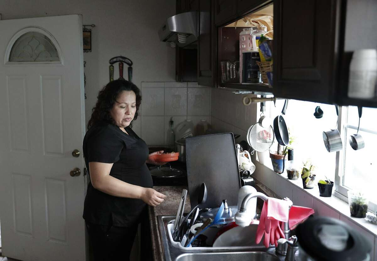 Maria Mendoza Sanchez prepares her lunch before she leaves for work from her home in Oakland, Calif., on Tuesday, August 8, 2017. Mendoza Sanchez and her husband Eusebio are from Mexico, and the pair have four children -- three of whom are U.S. citizens. But the couple faces deportation next week.