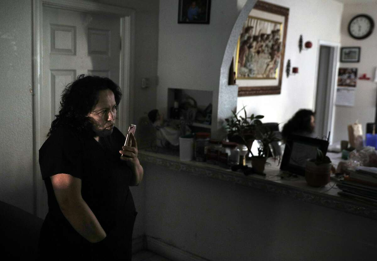 Maria Mendoza Sanchez talks with a reporter about possibly having her family split by a Department of Homeland Security order to leave the country at her home in Oakland, Calif., on Tuesday, August 8, 2017. Mendoza Sanchez and her husband Eusebio are from Mexico, and the pair have four children -- three of whom are U.S. citizens. But the couple faces deportation next week.