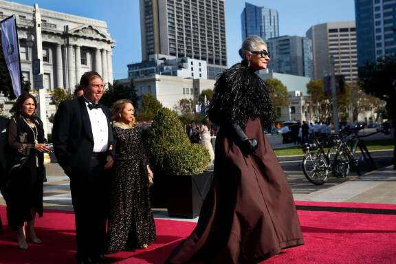 Joy Bianchi walks down the red carpet before the Opera Ball in San Francisco. Bianchi was forced out as the director of Helpers, Inc. last week.
