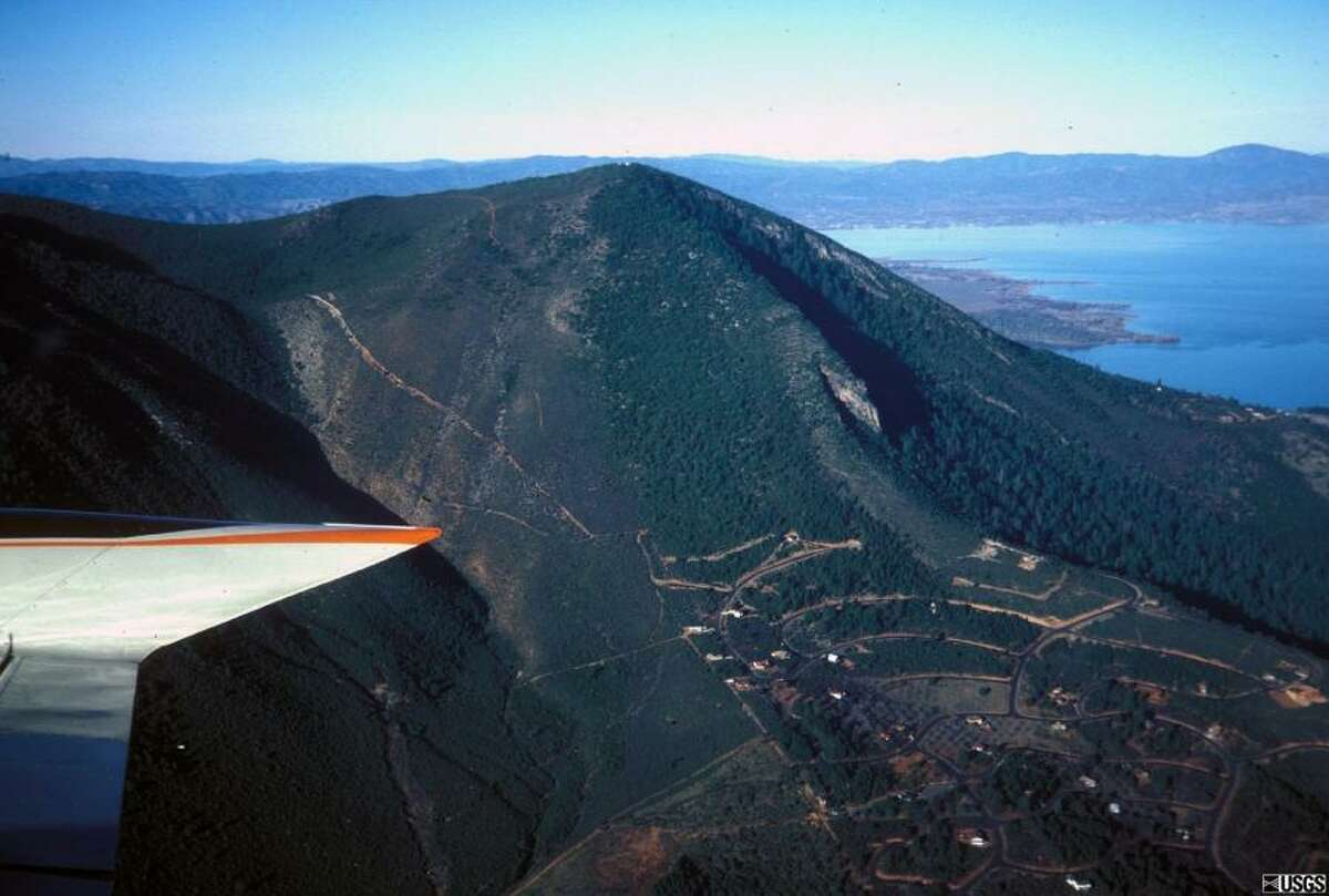 USGS caption: Mount Konocti, a 1,312 m (4,305 ft) mountain on the eastern shore of Clear Lake and the housing developments on its flanks. Mt. Konocti erupted during the most recent stage of volcanism more than 10,000 years ago, and a future eruption from the same site would be devastating to the nearby inhabitants.