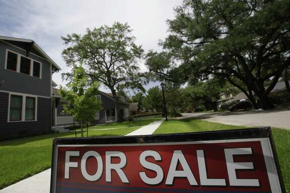 A for sale sign is displayed outside a home along Ashland St. Wednesday, July 12, 2017 in Houston. ( Melissa Phillip/ Houston Chronicle)