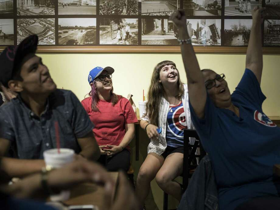 Cubs' fans cheer during a World Series game in 2016 at Wrigleyville Grill. The North Side restaurant has had its positive Facebook rating restored. Photo: Matthew Busch /For The San Antonio Express-News / © Matthew Busch