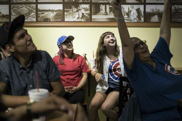 Cubs' fans cheer during a World Series game in 2016 at Wrigleyville Grill. The North Side restaurant has had its positive Facebook rating restored.