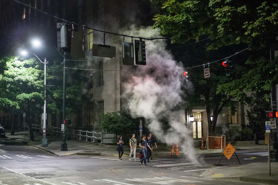 A group heads towards the Seattle Ferry Terminal at 12:24 a.m. on Wednesday, Aug. 9, 2017. Photo: GRANT HINDSLEY, SEATTLEPI.COM / SEATTLEPI.COM
