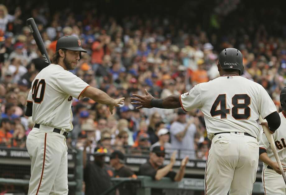 San Francisco Giants' Pablo Sandoval (48) is greeted by Madison Bumgarner, left, after scoring the Giants' first run in the second inning of a baseball game Wednesday, Aug. 9, 2017, in San Francisco. Photo: Eric Risberg, Associated Press