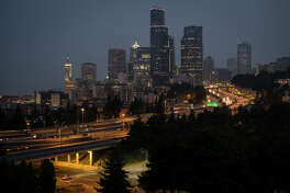 I-5 begins to light up as the city wakes at 5:25 a.m. on Wednesday, Aug. 9, 2017.