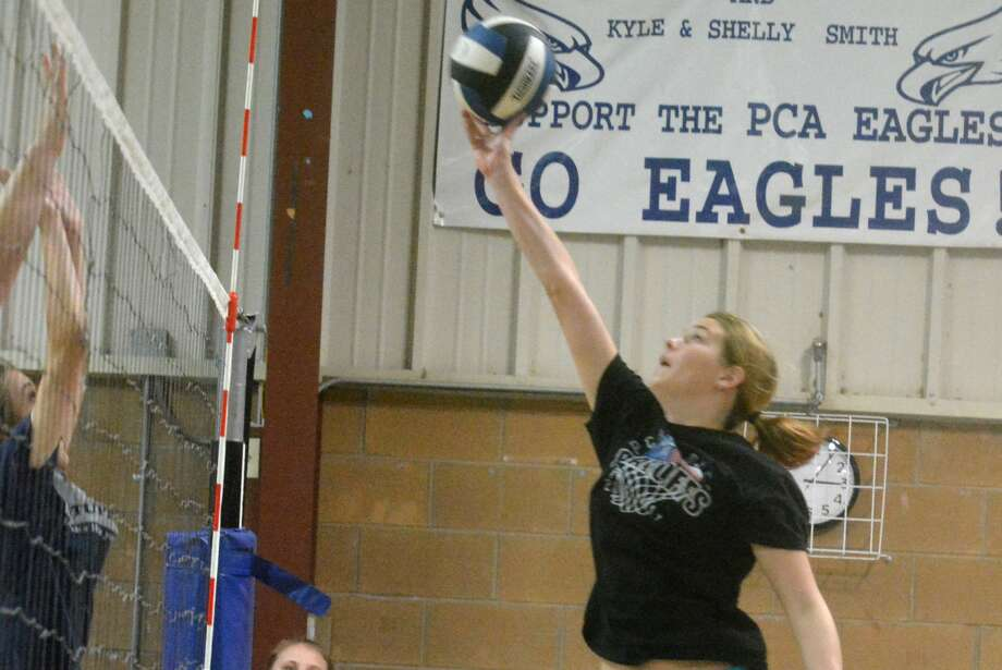 Plainview Christian Academy's Kylee Hill tips the ball over the net during a recent volleyball practice. Hill is one of three seniors on a veteran team that is hoping to make a run to the TAPPS state tournament this year. Photo: Skip Leon/Plainview Herald